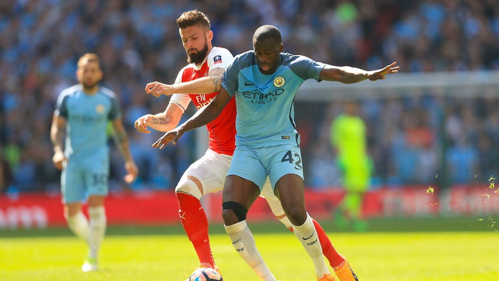 STRENGTH: Toure and Giroud battle for the ball.