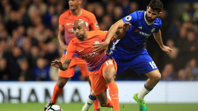 STRENGTH:Fabian Delph battles with Costa for the ball.