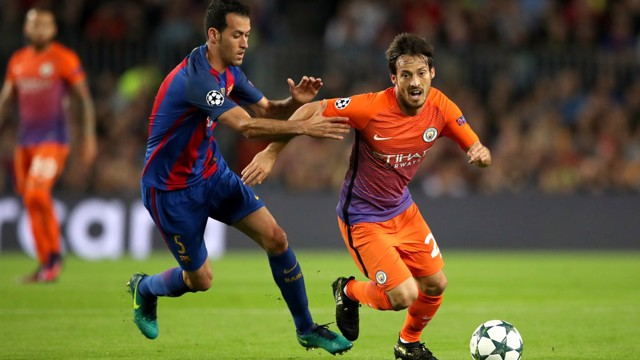 BATTLE: Manchester City's David Silva takes on Barcelona's Sergio Busquets