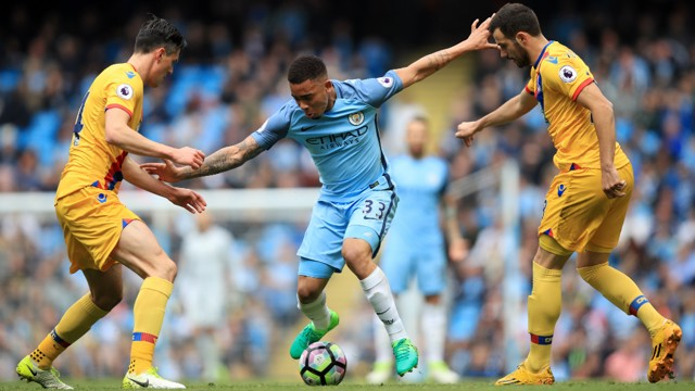 CROWDED: Gabriel Jesus looks to take on Martin Kelly.