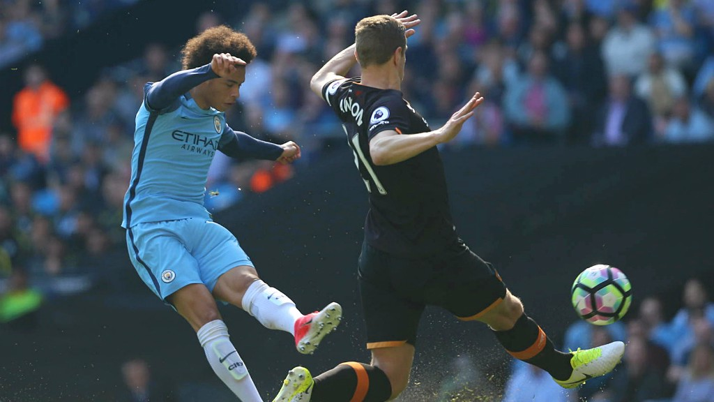 LEROY!: Sane gets a shot away under heavy pressure from Michael Dawson.