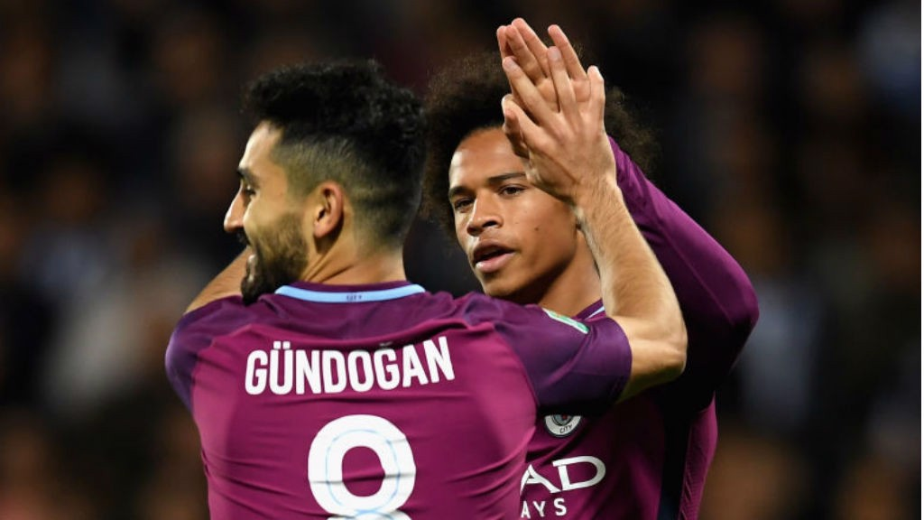 CUP CRACKER: Ilkay Gundogan congratulates team-mate Leroy Sane after his early strike