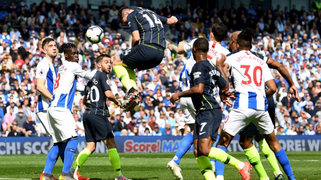 HIGH JUMP: Aymeric Laporte rises highest to give City a 37th minute lead.