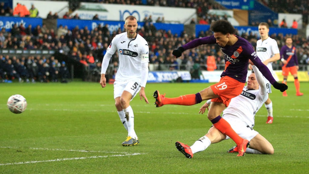 CLOSE CALL: Leroy Sane unleashes a left-foot shot on the Swansea goal