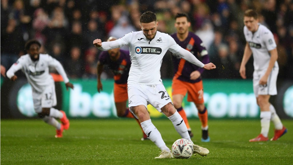 BLOW: Matt Grimes converts the spot-kick to give Swansea the lead