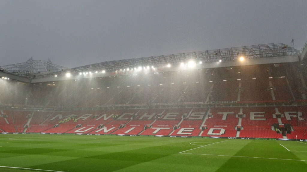 WET, WET, WET: Old Trafford was subjected to a torrential downpour a couple of hours ahead of kick-off