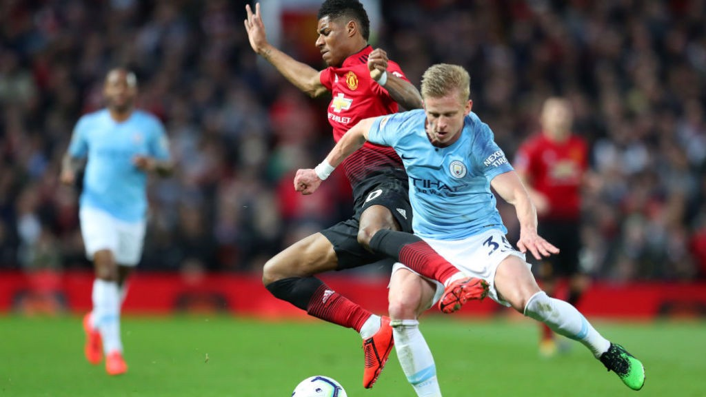 COLLISION COURSE: Oleks Zinchenko and Marcus Rashford are at full throttle