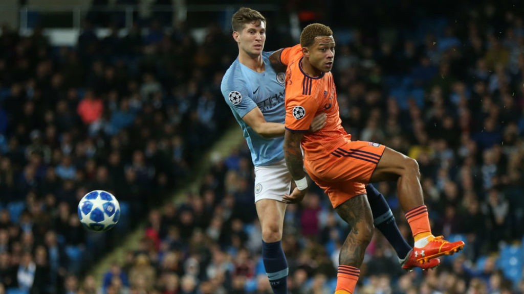 TIME TO RESPOND: John Stones in action against Lyon's Memphis Depay