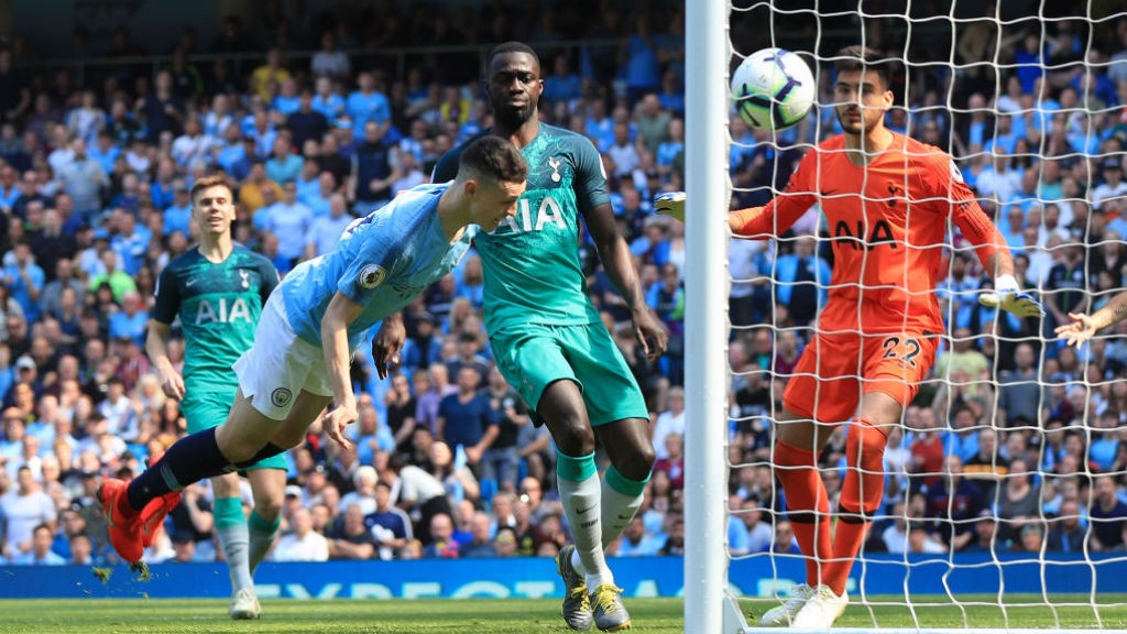HEAD BOY: Phil Foden finds the target from close-range to give City the perfect start