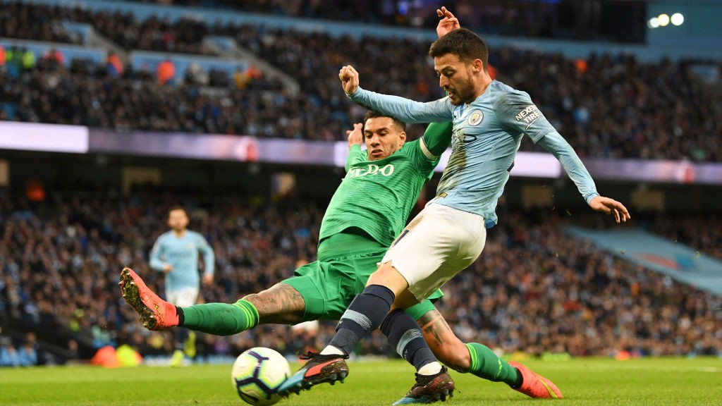 ALL FIRED UP: David Silva powers in a shot on goal