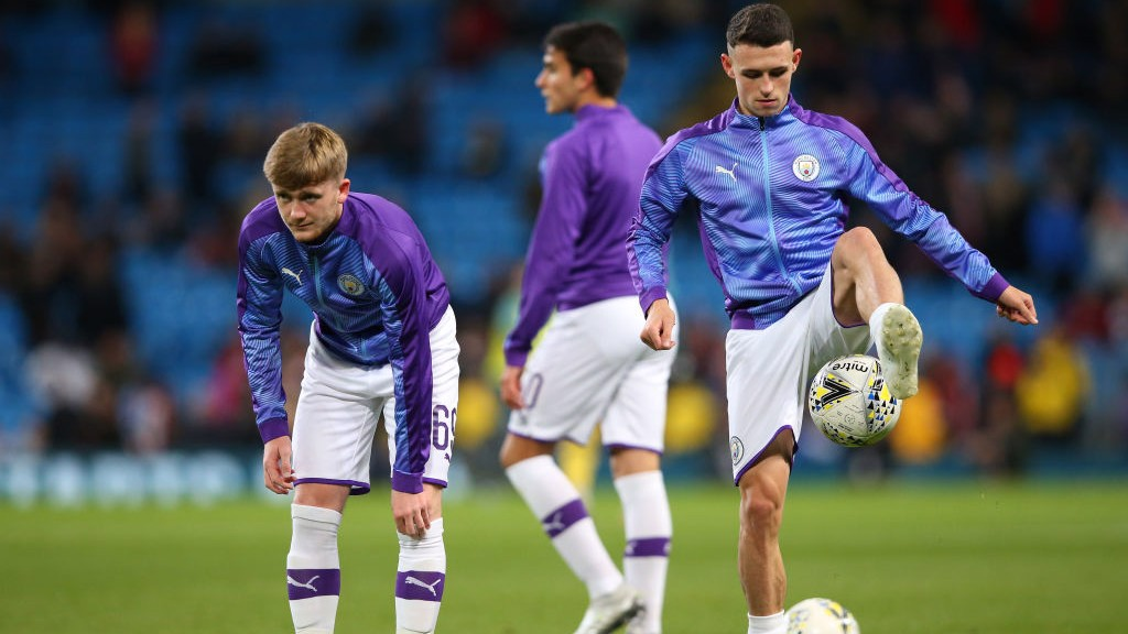 ACADEMY GRADUATES: Tommy Doyle, Phil Foden and Eric Garcia get set in the warm-up.