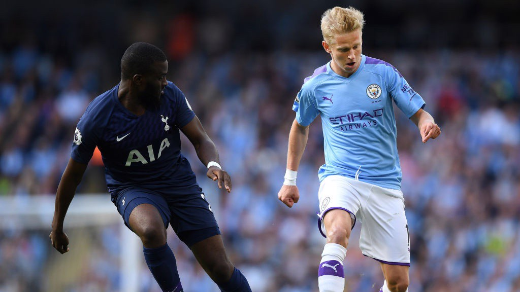 PRESSURE: Oleksandr Zinchenko drives forward.