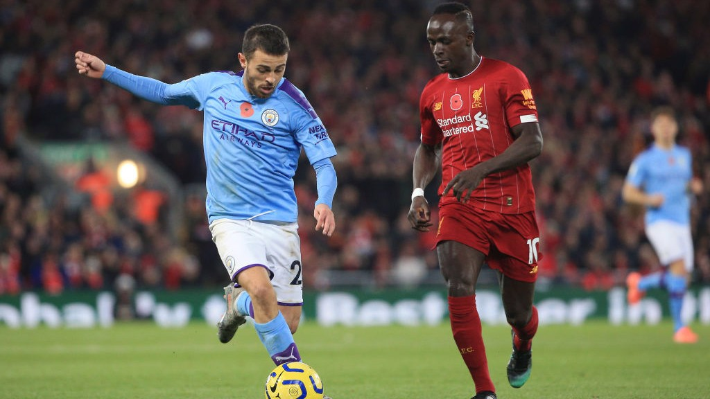 HEAD TO HEAD: Bernardo drives at the Reds' defence after Liverpool took an early lead through Fabinho.