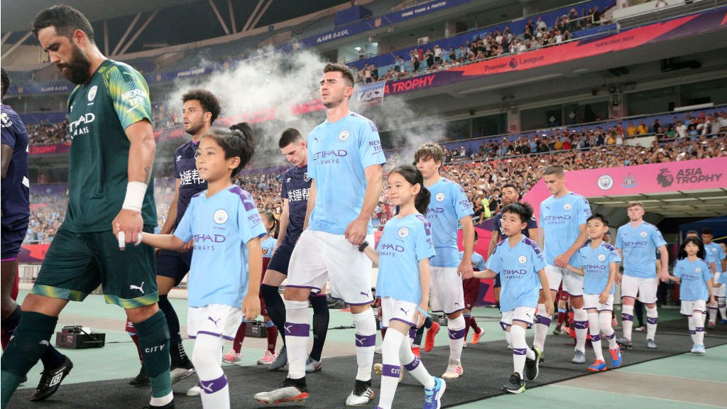 CALL OF DUTY: The City team stride out ahead of kick-off in Nanjing