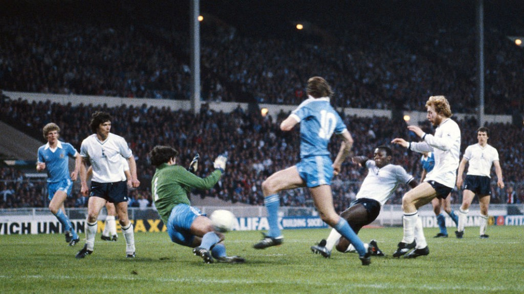TRACKING BACK: Tommy Hutchison does his best to get back as Garth Crooks scores against City in the 1981 FA Cup final replay.